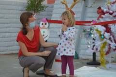 Children from Le Petit Poucet meet Santa Klaus.